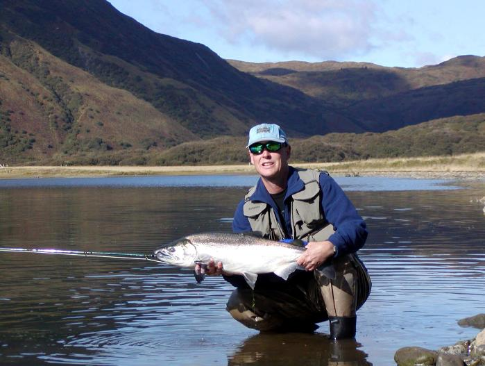 The rod builder with a 14# Silver from the Pasagshak River on Kodiak Island, Alaska